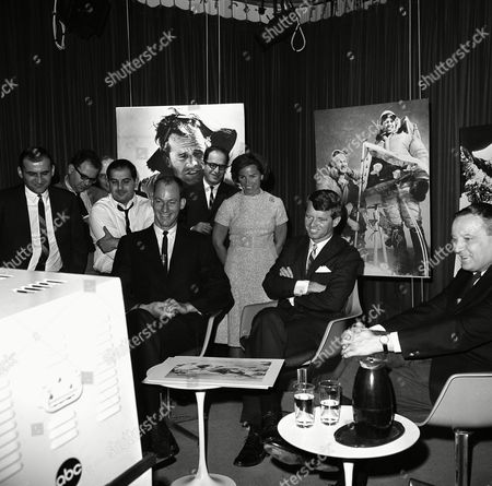 Sen. Robert Kennedy, D-N.Y., narrates the filmed story of his recent climb to summit of Mount Kennedy, at studios of American Broadcasting Company in Washington on . With him is James Whittaker of Seattle,left, who was one of the climbers with Kennedy. Kennedy and Whittaker listen to the playback of tape with Mrs. Ethel Kennedy standing in rear