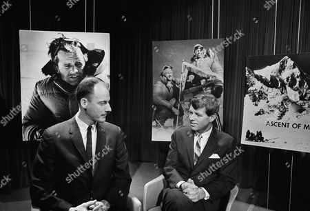 Sen. Robert Kennedy, D-N.Y., narrates the filmed story of his recent climb to summit of Mount Kennedy, at studios of American Broadcasting Company in Washington on . With him is James Whittaker of Seattle, left, who was one of the climbers with Kennedy