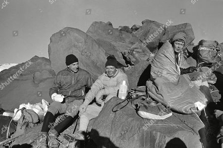 Robert McNamara, Stanley Livingston Secretary of Defense Robert S. McNamara, right, and Dr. Stanley Livingston of the University of California at San Diego rest at the summit of 14,410-foot Mount Rainier after reaching the peak, in Washington. McNamara's son and daughter also made the ascent. McNamara and his family plan to return to Washington, D.C., today, ending their one-week vacation in the Pacific Northwest