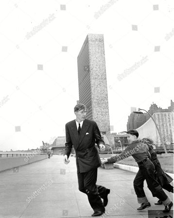 Stock Photo of ROGER BANNISTER Roger Bannister, the first to break the four minute mile, runs with Richard Gibbs and Eileen McCrann on the grounds of the United Nations headquarters in New York on