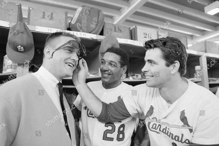 Roger Maris, Vada Pinson, and Mike Shannon Roger Maris visited the St. Louis Cardinals clubhouse and met his replacement Vada Pinson, center, and Mike Shannon in St. Petersburg, Florida, . Maris retired is in business in Gainesville, Florida. Pinson was obtained from the Cincinnati Reds