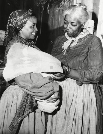 """Stock Photo of Ethel Waters, Mimi Dillard Slavery times are recreated in a scene between Ethel Waters (right) and Mimi Dillard for """"Go Down, Moses,"""" on which will be broadcast on Friday, November 1, on CBS-TV's """"The Great Adventure."""" Miss Waters stars and Miss Dillard is featured in the story of African American heroine Harriet Tubman's first experience as an Underground Railroad conductor in pre-Civil War days"""