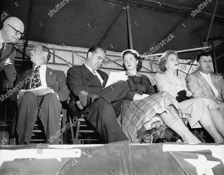Joseph McCarthy, Jean McCarthy, Douglas Marshall Sen. Joseph McCarthy (R-Wis) makes a final note on his San Jacinto Day speech near Houston on . His wife looks on while Mrs. Douglas Marshall, right, daughter of oilman millionaire H.R. Cullen, stars out at a crowd estimated by police at 9,000. Oilman Douglas Marshall is at right