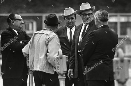 Lawrence Rainey, Cecil Price, Richard Andrew Wikkis Neshoba County Sheriff Lawrence Rainey (right) and Deputy Cecil Price wear look-alike western style hats as they chat outside the courthouse in Meridian, Miss., where they are on trial on conspiracy charges in the 1964 slaying of three civil rights workers. At far right is Richard Andrew Willis, another of 18 defendants in the case