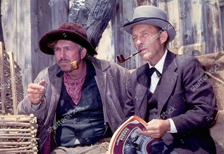 "Slim Pickens, left, and Bing Crosby are shown together on location during the filming of the movie ""Stagecoach"