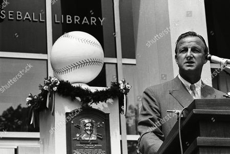 Stan Musial, one of baseball greats, of the St. Louis Cardinals, and now a member of the Hall of Fame, was visibly shaken which brought tears to his eyes, as he spoke of his days as a baseball player, in Cooperstown, New York. Musial?s plaque hangs in background. Man at left is unidentified