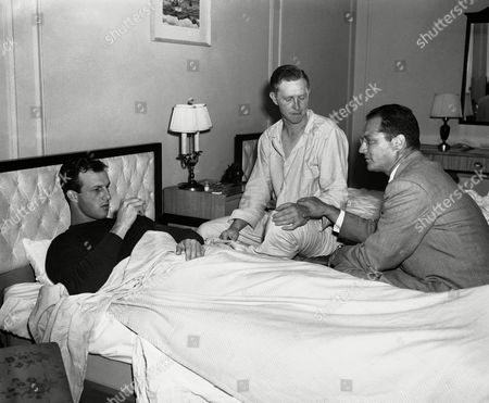 Stan Musial, Red Schoendienst, Allen Tanney Outfielder Stan Musial, left, tries to read his own temperature and infielder Red Schoendienst (center) has his pulse checked by Dr. Allen D. Tanney in their room at the Commodore Hotel in New York, . Dr. Tanney, who is treating them and other members of the flu-ridden St. Louis Cardinals, said they would be out of the lineup for at least a week. The other ?Pretty Sick? players are pitchers Howie Pollet, Harry Brecheen and George Munger