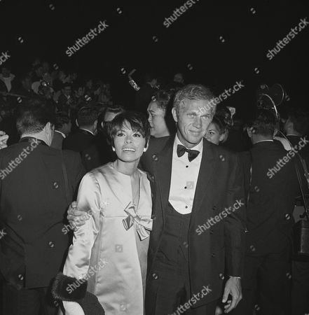 """Steve McQueen, a nominee as"""" best actor of the year,"""" arriving with wife, Neile Adams, arrive for Academy Awards on April 10,1967 in Los Angeles"""