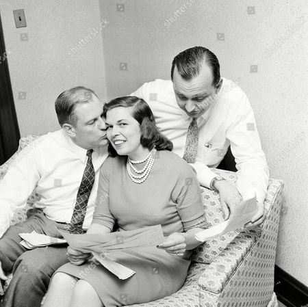 George Ratterman, Anne Ratterman, Tom Paisley Thomas J. Paisley, right, a Cleveland, Ohio, businessman, is pictured with George Ratterman, left, and Ratterman's wife Anne, at the Ratterman home in Newport, Ky., after he revealed himself as the mutual friend who brought Ratterman together with Tito Carinci, Newport hotel and night club manager. Earlier today Ratterman was arrested with a stripper in Carinci's apartment and charged with disorderly conduct, resisting arrest and breach of the peace. Paisley said he left Ratterman and Carinci discussing a business deal