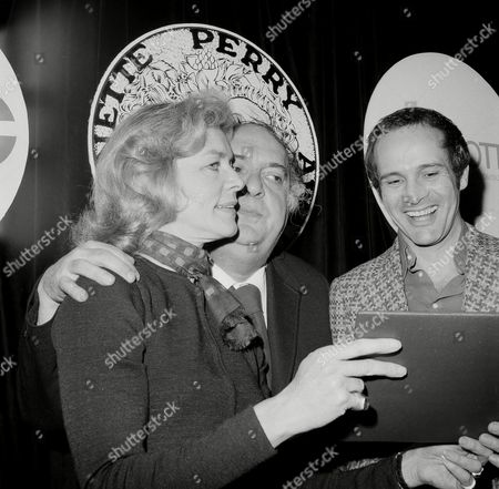 Lauren Bacall, Zero Mostel Lauren Bacall gets a hug form Zero Mostel during a press party for the 1971 Antoinette Perry (Tony) award nominees at Sardi's restaurant in New York, . The Tony, Broadway's most prestigious theater award will be presented on March 28. Man at right is unidentified