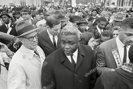 "Former baseball star Jackie Robinson, center, appears with demonstrators in a civil rights march on the capitol in Frankfort, Ky. Robinson is the subject of a two-part documentary, ""Jackie Robinson"" directed by Ken Burns, Sarah Burns and David McMahon airing Monday and Tuesday at 9 p.m. on most PBS stations"