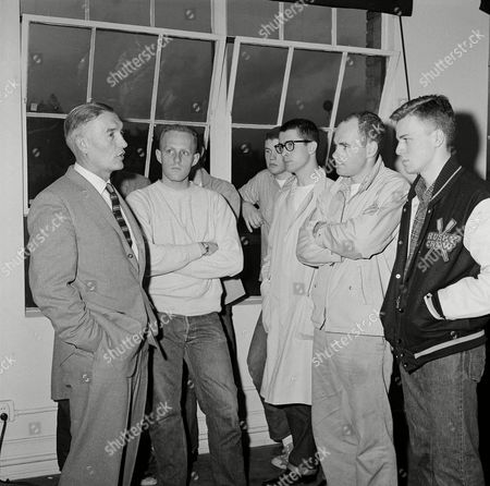 Stock Image of Al Ulbrickson Sr., Ward Phillips, Ralph Warford, Jim Wise, John Lind, Bob Svensen Al Ulbrickson, left, University of Washington rowing coach for 32 years and perhaps the most renowned crew coach of the day, tells shocked student of his decision to resign, in Seattle. Student crewmen who crowded into a press conference room after word of the resignation got out seemed stunned. Students, from left: Ward Phillips, Ralph Warford, Jim Wise, John Lind and Bob Svensen
