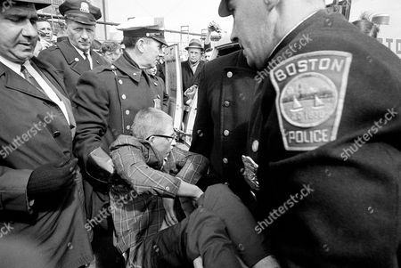 David Benson David Benson, 18, formerly of Morgantown, W. Va., and now of Voluntown, Conn., as he is carried by Boston police to a waiting patrol wagon following a demonstration in front of the Boston Army base to protest U.S. involvement in Viet Nam. Benson tore up his draft card after an attempt to burn it during the demonstration. Ten other persons in the demonstration were also arrested and charged with loitering and obstructing traffic