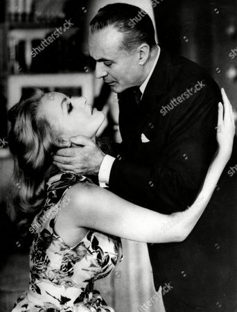 CHALES BOYER; JULIE NEWMAR French actor Charles Boyer, right, is seen in a romantic scene with American actress Julie Newmar, at a rehearsal of the smash Broadway hit 'The Marriage Go Round' in New York, USA, . The comedy will have its premier October 29, 1958