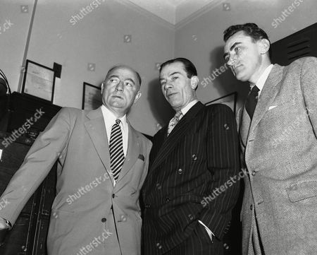Stock Image of Willie Sutton George W. Herz, left, and James F. McCardle, right, attorneys, Willie Sutton, center, at Brooklyn County Court for arraignment in New York, before Judge Goldstein on gun carrying charge