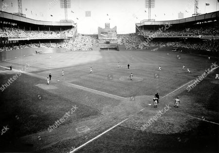 New York Giants pinch hitter Dusty Rhodes rounds first base after sending the ball into lower right field stands for a three-run, game-winning homer in 10th inning of World Series opener at the Polo Grounds in New York City on . The Giants defeated the Cleveland Indians, 5-2