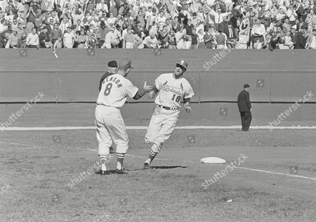 Mike Shannon, Vern Benson, Hank Soar Mike Shannon (18) gets a welcoming hand as he rounds third base on his two-run homer in the sixth inning of the first game of the World Series against the New York Yankees in Busch Stadium in St. Louis, . Congratulating him is Cardinals coach Vern Benson. Umpire is Hank Soar