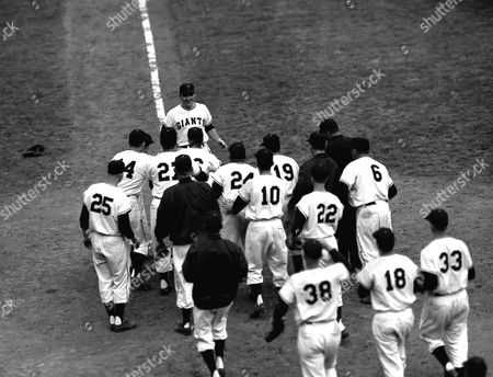 RHODES The New York Giants converge on home plate to greet pinch-hitter Dusty Rhodes as he comes in to score on his 10th-inning three-run homer to give the Giants a 5-2 win over the Cleveland Indians in the World Series opener at the Polo Grounds in New York City