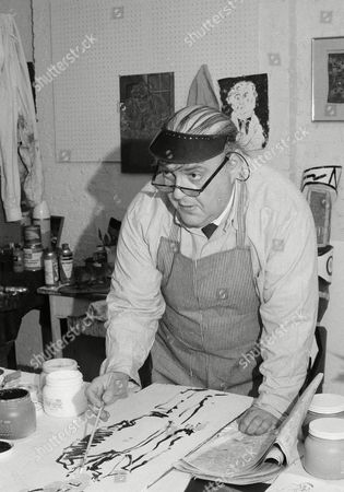 Actor Zero Mostel works on sketch in his mid-Manhattan studio, . Mostel, regarded by many as one of the most versatile performers in the theater, spends more time at his first love--painting--than he spends on stage or before camera