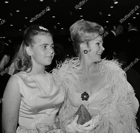 """Gabor Hilton Zsa Zsa Gabor, right, and her 16-year-old daughter Francesca Hilton are seen arriving for the premiere of the film """"Cleopatra,"""", in Hollywood"""