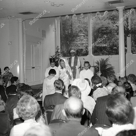 Zubin Mehta, Nancy Kovack Zubin Mehta and his bride Nancy Kovack during the Zoroastrian wedding ceremony in Los Angeles on performed by Paris high priest Dr. Framroze Areshir Bode, standing background, wearing the long, flowing white robe of his priesthood, with a white turban of 12 yards of startched white cloth. The bridegroom's mother (back to camera) kneels before the bridal couple. Mehta's father is at right, wearing black skull cap