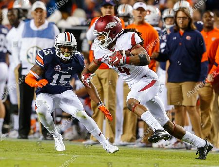 Jason Smith, Joshua Holsey Auburn wide receiver Jason Smith (4) catches a pass as Auburn defensive back Joshua Holsey (15) tries to cover during the first half of an NCAA college football game, in Auburn, Ala