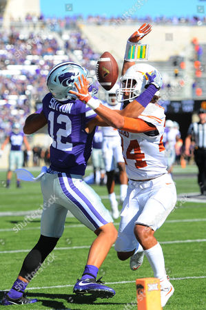 Texas Longhorns cornerback John Bonney (24) is called for pass interference on a pass intended for Kansas State Wildcats wide receiver Corey Sutton (12) during the NCAA Football game between the Texas Longhorns and the Kansas State Wildcats at Bill Snyder Family Stadium in Manhattan, Kansas