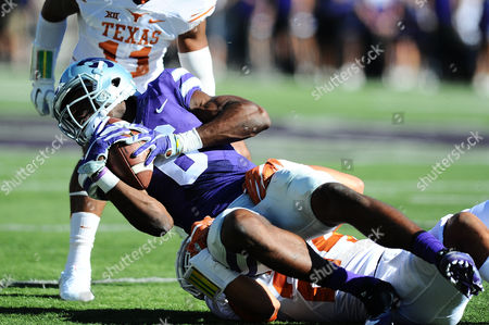 Kansas State Wildcats wide receiver Deante Burton (6) is tackled after a reception by Texas Longhorns cornerback John Bonney (24) during the NCAA Football game between the Texas Longhorns and the Kansas State Wildcats at Bill Snyder Family Stadium in Manhattan, Kansas