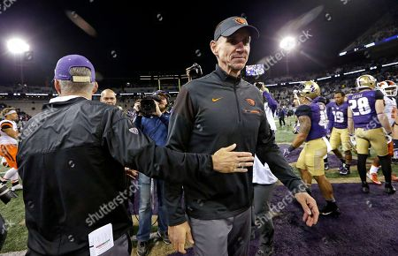 Chris Petersen, Gary Andersen Washington head coach Chris Petersen, left, gives Oregon State head coach Gary Andersen a pat after they greeted each other at the end of an NCAA college football game, in Seattle. Washington won 41-17