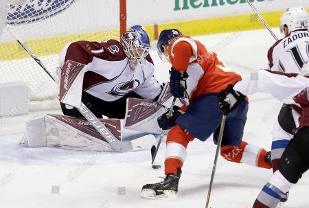 Semyon Varlamov, Shane Harper Colorado Avalanche goalie Semyon Varlamov (1) prepares to block a shot by Florida Panthers right wing Shane Harper (38) in the first period of an NHL hockey game, in Sunrise, Fla
