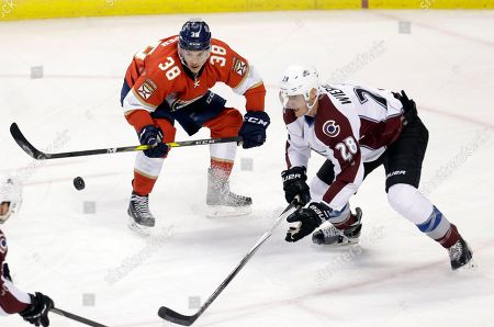 Shane Harper, Patrick Wiercioch Florida Panthers right wing Shane Harper (38) and Colorado Avalanche defenseman Patrick Wiercioch (28) battle for the puck in the second period of an NHL hockey game, in Sunrise, Fla