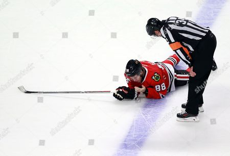 Brad Meier, Patrick Kane Referee Brad Meier (34) checks on Chicago Blackhawks right wing Patrick Kane (88) who took a high stick to the face during the overtime period of an NHL hockey game against the Toronto Maple Leafs, in Chicago