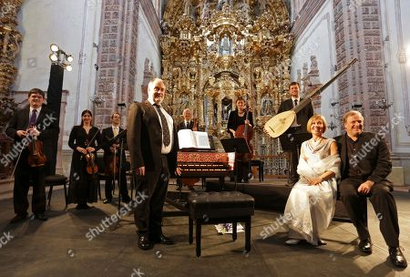 John Butt., Mhairi Lawson, Matthew Brook, Huw Daniel, Alice Evans, Alfonso Leal del Ojo, William Hunt, contrabass, Catherine Rimmer, Alexander McCartney The Dunedin Consort ensemble from Scotland poses for photographers prior to their performance at the Valenciana Temple in Guanajuato, Mexico, . The ensemble is in Mexico to participate in this year's International Cervantes Festival. At center is music director John Butt. At right front are Mhairi Lawson, soprano and Matthew Brook, baritone. Behind, from left, are Huw Daniel, first violin, Alice Evans, second violin Alfonso Leal del Ojo, viola, William Hunt, contrabass, Catherine Rimer, cello, and Alexander McCartney, theorbo