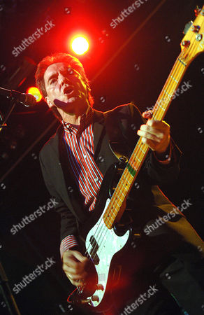 Stock Image of Bruce Foxton. The Jam featuring original members: guitarist/vocals Bruce Foxton and Rick Buckler on drums.
