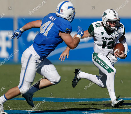 Dru Brown, Patrick Healy Hawaii Warriors quarterback Dru Brown (19), right, runs for a short gain as Air Force Falcons linebacker Patrick Healy (41) pursues in the second half of an NCAA college football game, at Air Force Academy, Colo. Hawaii won 34-27 in double overtime