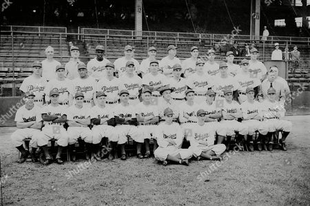 DODGERS Members of the National League Pennant bound Brooklyn Dodgers are pictured at Ebbets Field, . Left to right front are Stan Strull, batboy and Norman Berman, ballboy. First row are Pete Reiser, Stan Rojek, Al Gionfriddo, Eddie Stanky, Vic Lombardi, coach Jake Pitler, manager Burt Shotton, coach Clyde Sukeforth, unidentified coach, Cookie Lavagetto, Hank Behrman, Peewee Reese. Second row: Eddie Miksis, Johnny Jorgensen, Dan Bankhead, Gene Hermanski, Gil Hodges, Hal Gregg, Carl Furillo, Rex Barney, Harry Taylor, Ralph Branca, Harold Parrott. Third row: trainer Harold Wendler, property man Dan Comerford, Jackie Robinson, Hugh Casey, Joe Hatten, Dixie Walker, Clyde King, Bobby Bragan, Bruce Edwards, Arky Vaughan, assisstant property man John Griffin