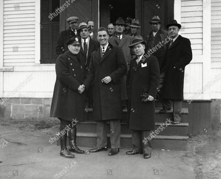 """Franklin Delano Roosevelt, Jr., (center), poses in Orange, Connecticut, after he paid a fine of $10 for speeding. He shakes hands with Constable Joseph Cummings, the officer who stopped him. At right is David Torrance, town prosecutor. Young Franklin pleaded """"guilty"""" as soon as the case was called, promising not to speed again"""