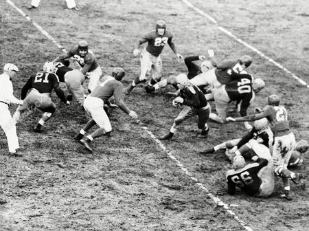 Andy Uram, Mel Hein, Pete Tinsley, Bill Lee, George Svendsen, Jim Poole Andy Uram of the Green Bay Packers cracks through a hole in the center of the line to run smack into Mel Hein (7) New York Giants center, in the first quarter of a National Professional Football League game in New York City, . Uram made just one yard on the play. The Giants won, 7-3. Identifiable players: Packers Pete Tinsley (21) guard Bill Lee (40) tackle and George Svendsen (66) center; Giants Jim Poole (23) end