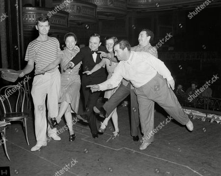 "E. D. Rivers, Eurith Dickinson Rivers, Buddy Ebsen, Judy Canova, Dixie Dunbar; Jack Pearl, Lew Brown Some of the stars of ""Yokel Boy"" show Gov. E. D. Rivers of Georgia how to dance in the line of a musical comedy in New York, . The Gov. is in New York to see his state's exhibit at the World's Fair. Left to right are: Buddy Ebsen; Judy Canova; Gov. Rivers; Dixie Dunbar; Jack Pearl and producer Lew Brown"