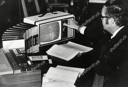 Watchf Associated Press Domestic News United States APHS HIGH CALIBRE FACULTY Robert Ferguson, a participant in the pilot study for the Universal College Program in this undated photo, adjusts the fine tuning knob on his home television as he prepares to watch a lecture. Professors for the video taped courses were chosen from five cooperating colleges located throughout the United States on the basis of their expertise and ability to communicate their subject matter effectively to students