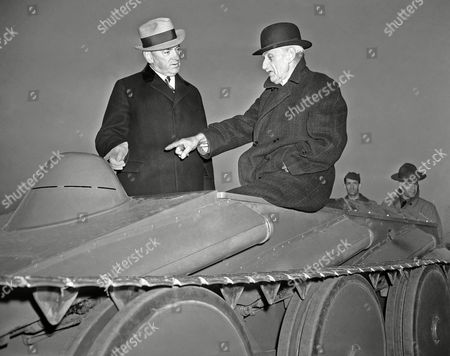 John Walter Christie, James Curley J. Walter Christie, right, 70-year-old inventor, shows tank to Governor James M. Curley on