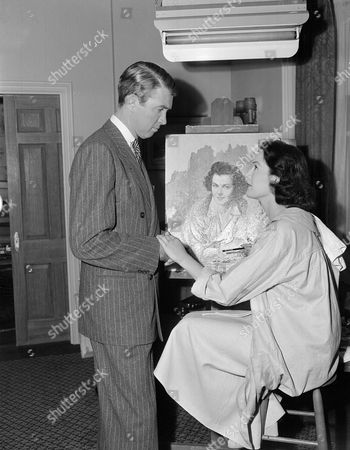 """Jimmy Stewart, Patricia Medina Film star Jimmy Stewart checks on a painting of his movie wife, Barbara Hale, which Patricia Medina, British actress, is doing for a scene in """"The Jackpot"""" in Hollywood, Los Angeles, California on . Artist Medina is one of the prizes which Stewart wins, along with a load of trouble, in the film"""