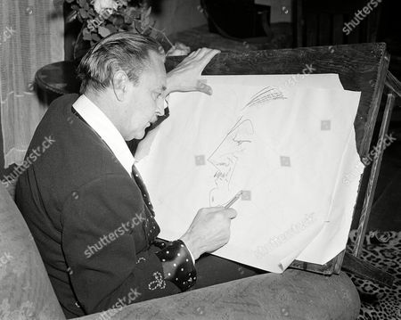 John Barrymore Actor John Barrymore draws a self portrait on profile in Los Angeles, Calif