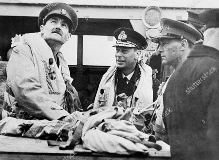 King George VI, Allen Lascelles, Robert Laycock Left to right: Sir Allen Lascelles, King George VI of England, and Maj. Gen. Robert Laycock, Chief of Combined Operations, discuss invasion operations on the bridge of HMS Arthusa in June 1944 during a cross channel voyage following, which the King visited the French invasion beachhead