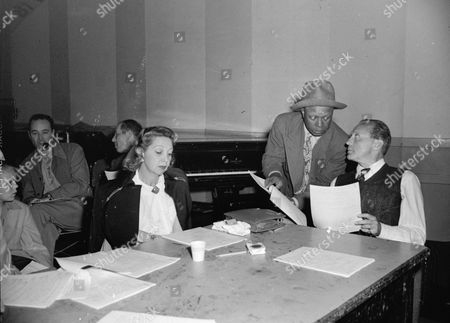From left to right: Mary Livingston, Eddie Anderson, and Jack Benny, rehearsing a radio broadcast in Hollywood on