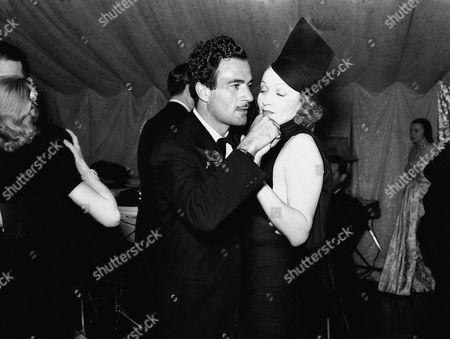 Marlene Dietrich, Gilbert Roland Marlene Dietrich, screen actress, dancing with Gilbert Roland, film player, at a party given by Basil Rathbone, actor, and Mr. S. Rathbone in their Hollywood, California, home on