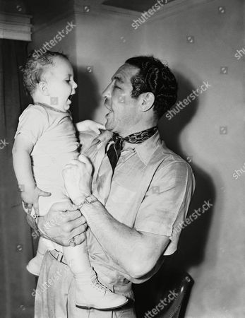 Max Baer Papa Maxie Baer had a time explaining to son Maxie, Jr. how he happened to get that black eye in his bout the night before with Lou Nova in New York. But on the right Maxie shows his son how to laugh off a licking