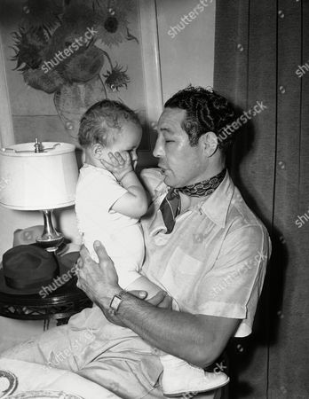 Max Baer Papa Maxie Baer had a time explaining to son Maxie, Jr., how he happened to get that black eye in his bout the night before with Lou Nova in New York. But on the right Maxie shows his son how to laugh off a licking