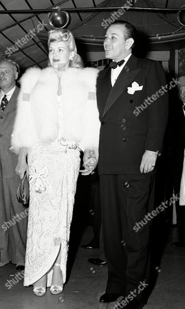 """Betty Grable and George Raft arrive for the movie premiere of """"Tales of Manhattan"""", at Sid Grauman's Chinese Theatre in Los Angeles, Calif. . Stars flocked to the famous movie house to take a look at the combined efforts of a star-studded cast. Screen luminaries in """"Tales of Manhattan"""" includes Boyer, Rita Hayworth, Ginger Rogers, Henry Fonda, Edward G. Robinson, Charles Laughton, Ethel Waters, Paul Robeson, and Rochester. This Photo shows Betty Grable"""