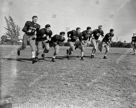 Phil Tinsley, Deane Gaines, Maurice Furchgott, Roland Phillips, Paul Duke, Jack Glenn, Charles Murdock Seven of Georgia Tech's top linemen put on a show before the battle charge at Miami's Orange Bowl, while warming up for the New Year's game with Tulsa. From left: Phil Tinsley, Deane Gaines, Maurice Furchgott, Roland Phillips, Paul Duke, Jack Glenn and Charles Murdock